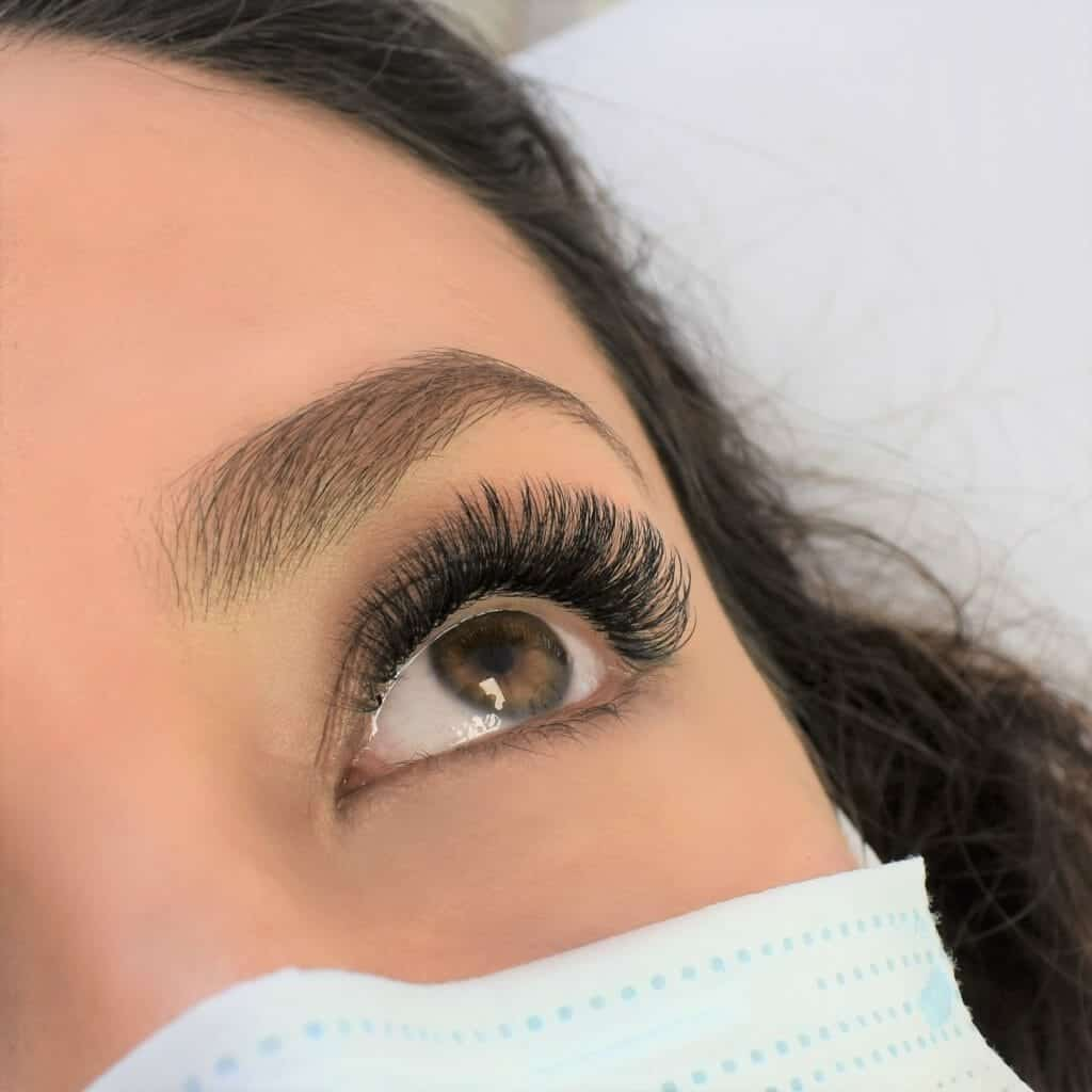 Woman with natural volume eyelash extensions.