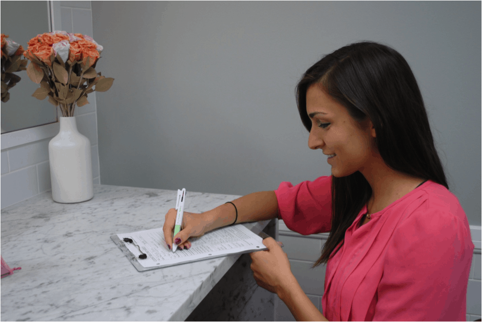 Client filling intake form during consultation