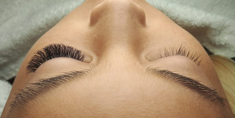 Women with volume lashes on left eye and no lashes on right eye