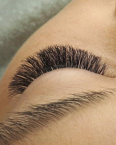 Women with volume eyelash extensions.