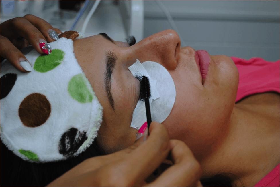 Eyelash stylist checking her work
