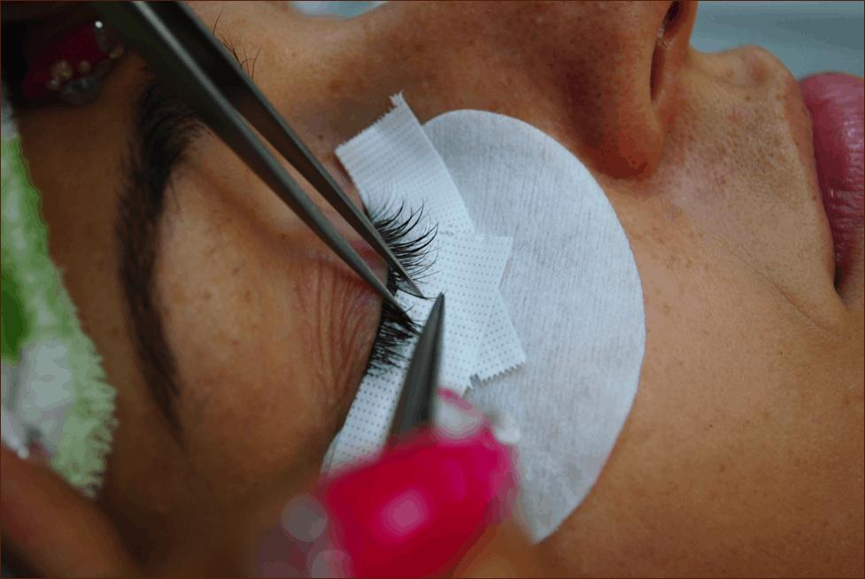 Eyelash stylist isolating and applying lashes