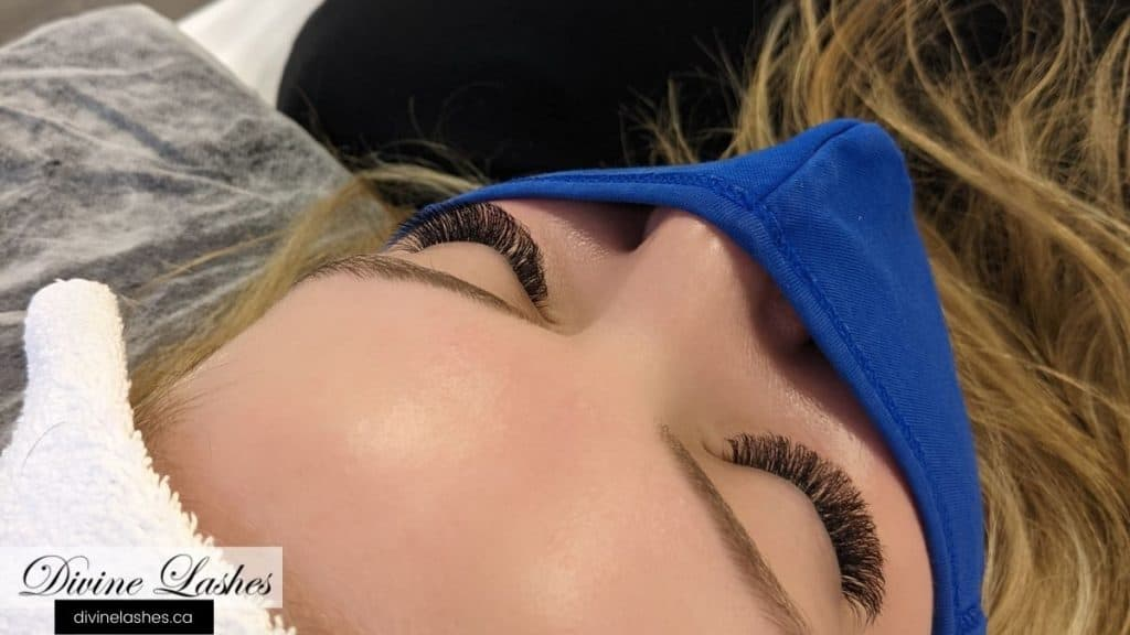Client with beautiful eyelash extensions with eyes closed
