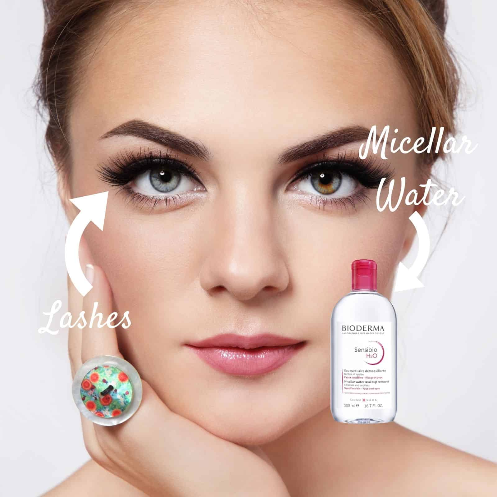 Woman using micellar water to clean eyelash extensions