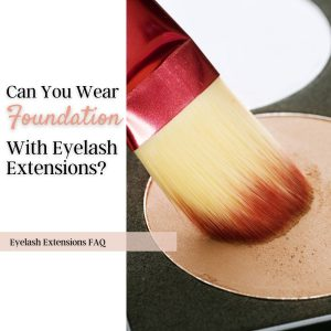 Can you wear foundation with eyelash extensions? A foundation brush on a palette.