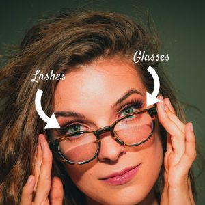 Woman wearing glasses with eyelash extensions