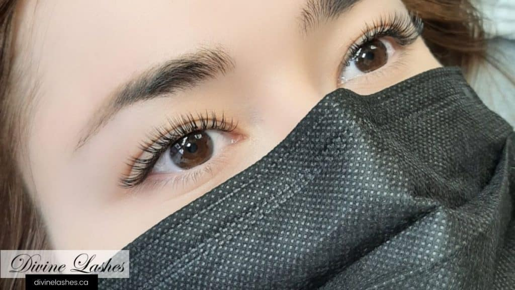 Woman with beautiful eyelash extensions. Showing that magnetic lashes on top of eyelash extensions is unnecessary.
